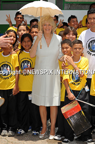 "CAMILLA, DUCHESS OF CORNWALL.Visits a centre for arts and education on a poor area of Manaus where the Duchess had a touching moment with one of the children of ""Curumim na Lata"" (Children of the can-percussion)  ..Forth day Brazil on the second leg of their South American Tour, Manaus, Brazil_14/03/09....Mandatory Credit Photo: ©DIAS-NEWSPIX INTERNATIONAL..Please telephone : +441279324672 for usage fees..**ALL FEES PAYABLE TO: ""NEWSPIX INTERNATIONAL""**..IMMEDIATE CONFIRMATION OF USAGE REQUIRED:.Newspix International, 31 Chinnery Hill, Bishop's Stortford, ENGLAND CM23 3PS.Tel:+441279 324672  ; Fax: +441279656877.Mobile:  07775681153.e-mail: info@newspixinternational.co.uk"
