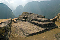 A carved natural rock overlooking the Urubamba Valley at Machu Picchu in Peru.