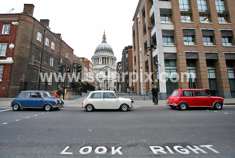 **ALL ROUND PICTURES FROM SOLARPIX.COM**.**NO UK NEWSPAPER PUBLICATION **UK MAGAZINE & SUPPLEMENT PUBLICATION ONLY** AND NO PUBLICATION IN FRANCE, SCANDINAVIA, AUSTRALIA AND GERMANY** .Three original 1968 Mark 1 Minis came to London to mark the world premiere of The Italian Job on Sky Movies HD on 16th March. The launch took in many London Landmarks and included a stop off for coffee at Bar Italia in London's soho. 5th March 2008..JOB REF: 5895 SFE       DATE: 05_03_2008.**MUST CREDIT SOLARPIX.COM OR DOUBLE FEE WILL BE CHARGED* *UNDER NO CIRCUMSTANCES IS THIS IMAGE TO BE REPRODUCED FOR ANY ONLINE EDITION WITHOUT PRIOR PERMISSION*