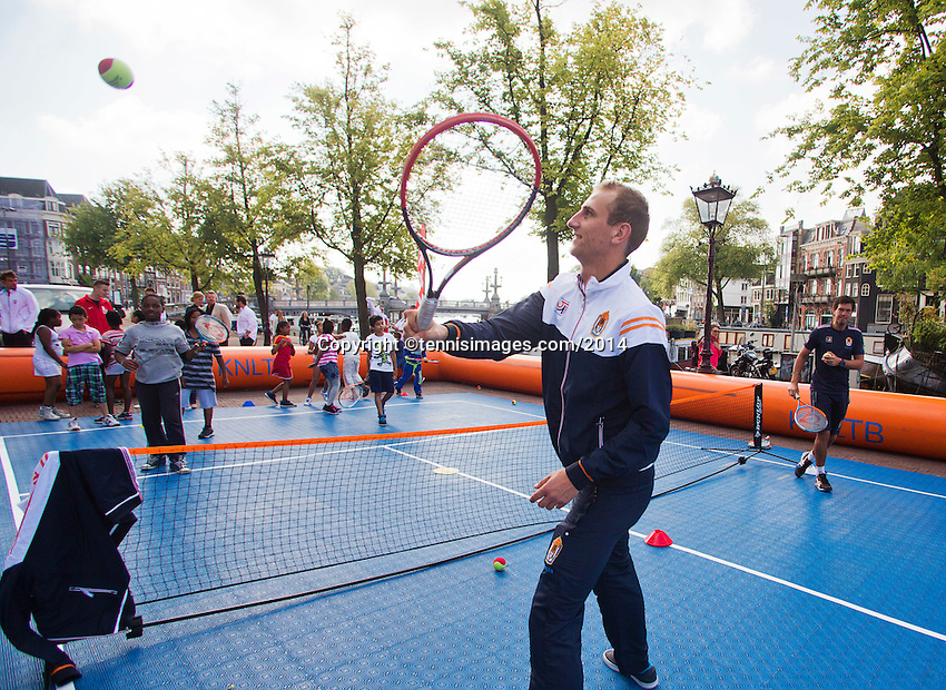 September 11, 2014, Netherlands, Amsterdam, Ziggo Dome, Davis Cup Netherlands-Croatia, Draw, Dutch players playing street tennis with kids in front off Ciyy hal, pictured: Thiemo de Bakker<br /> Photo: Tennisimages/Henk Koster