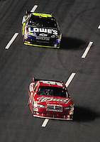 Oct. 17, 2009; Concord, NC, USA; NASCAR Sprint Cup Series driver Kasey Kahne leads Jimmie Johnson during the NASCAR Banking 500 at Lowes Motor Speedway. Mandatory Credit: Mark J. Rebilas-