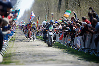 Australian National Champion Heinrich Haussler (AUS/IAM) leading the peloton over the extreme cobbles of sector 18: Trou&eacute;e d'Arenberg - Wallers Forest<br /> <br /> 113th Paris-Roubaix 2015