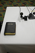 The Bible and microphones used on the stand during the week-long hearings by the State Board of Elections concerning the campaign finances of former Gov. Mike Easley.