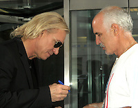 "August 06, 2012 Joe Walsh signs an autograph for a fan outside ""CBS This Morning"" studio in New York City to discuss his new solo album 'Analog Man'. © RW/MediaPunch Inc. /NortePhoto.com<br />