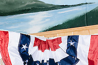 Bunting adorns the room as Vermont senator and Democratic presidential candidate Bernie Sanders speaks at a campaign event at the White Mountain Chalet event hall in Berlin, New Hampshire.