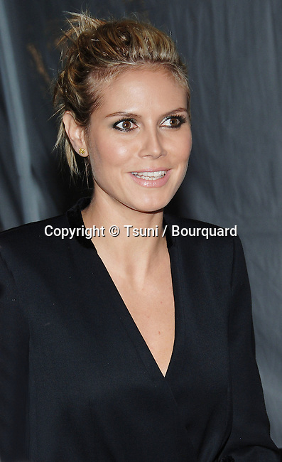 Heidi Klum arriving at the Vanity Fair and Entertainment Industry Foundation, Amped For Africa Celebrating the New Charlize Theron African Outreach Project Benefiting Oprah's Angel Network at Republic Restaurant in Los Angeles. March 2, 2006.