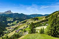 Italy, South Tyrol (Trentino - Alto Adige), La Valle: with its many hamlets, at background summit Peitlerkofel (Sass de Putia) at Puez-Geisler Nature Park (Parco naturale Puez Odle) | Italien, Suedtirol (Trentino - Alto Adige), Wengen: mit seinen vielen Weilern, im Hintergrund der Gipfel Peitlerkofel im Naturpark Puez-Geisler