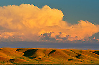 Clouds at sunset over prairie landscape. Western Block, Grasslands National Park, Saskatchewan, Canada