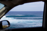Winter swells at Ho'okipa, Maui, framed by a car window.