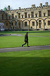 David Levenson, photographer, crosses Tom Quad at Christ Church during the FT Weekend Oxford Literary Festival, Oxford, UK. Wednesday 26 March 2014.<br /> <br /> PHOTO COPYRIGHT Graham Harrison<br /> graham@grahamharrison.com<br /> <br /> Moral rights asserted.