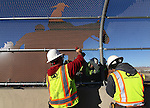 "Tony Ramirez, left, and Gabriel Delacerda, foreground, and Anthony Livengood and Mike Jennings with Q&D Construction, install ""cattle drive image panels"" on the Fairview overpass above the Highway 395 bypass on Monday afternoon in Carson City..Photo by Cathleen Allison"