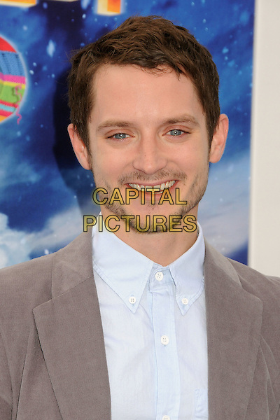 Elijah Wood.The World Premiere of 'Happy Feet Two' held at The Grauman's Chinese Theatre in Hollywood, California, USA..November 13th, 2011.headshot portrait stubble facial hair grey gray white blue shirt .CAP/ADM/BP.©Byron Purvis/AdMedia/Capital Pictures.