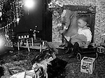 Wilkinsburg PA:  Brady Jr and Helen Stewart checking out the toys under the Christmas Tree - 1921.  Ghost affect on Helen is a result the long camera exposure required to capture the image.