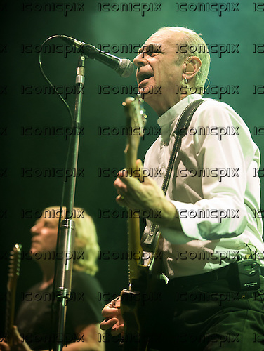 Status Quo-Lead Vocalist Francis Rossi performing live on at O2 Arena London UK - 15 December 2013.  Photo credit: Iain Reid/IconicPix