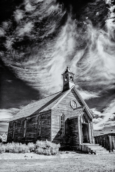 Black and white infrared image of old wooden church in Bodie California