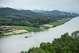 VIETNAM, Hue, an elevated view of the Perfume River, farmland, and a longtail boat