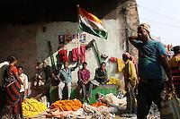 An Indian flag flies above a small market underneath the Howrah Bridge. November, 2013