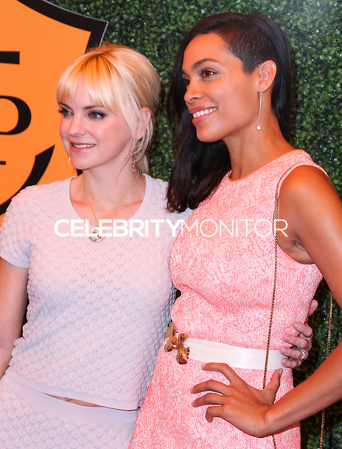 PACIFIC PALISADES, CA, USA - OCTOBER 11: Anna Faris, Rosario Dawson arrive at the 5th Annual Veuve Clicquot Polo Classic held at Will Rogers State Historic Park on October 11, 2014 in Pacific Palisades, California, United States. (Photo by Xavier Collin/Celebrity Monitor)