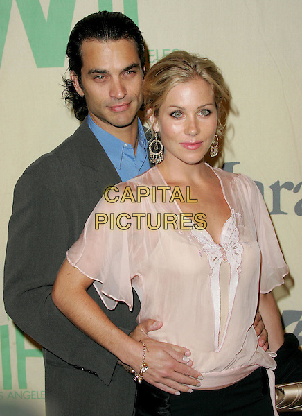 "JONATHAN SCHAECH & CHRISTINA APPLEGATE.Attend ""A Family Affair: Women in Film celebrates The Paltrow Family"" 2004 Crystal & Lucy Awards held at The Westin Century Plaza Hotel in Century City, California.June 18, 2004.half length, half-length, butterfly top, see through, see thru, floaty, summery, sheer, hands on hips, embrace.www.capitalpictures.com.sales@capitalpictures.com.©Debbie VanStory/Capital Pictures.."