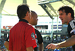 14 November 2004: Assistant referee Kermit Quisenberry (left) gets an earful from Ryan Nelsen (right) and Earnie Stewart (center) after confirming a handball call against DC United in the 57th minute that resulted in a penalty kick for Kansas City and a red card for Dema Kovalenko (not pictured). DC United defeated the Kansas City Wizards 3-2 to win MLS Cup 2004, Major League Soccer's championship game at the Home Depot Center in Carson, CA..