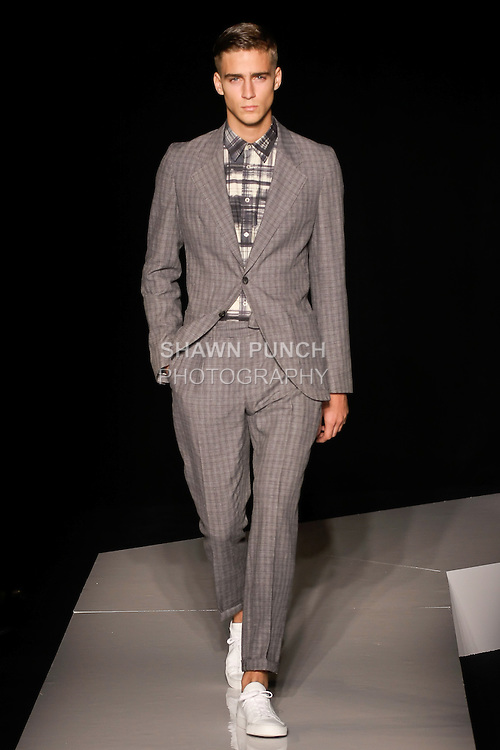 Samuel walks runway in a charcoal linen/wool textured notch unconstructed suit, and charcoal and beige cotton printed plaid sports shirt, from the Joseph Abboud Spring Summer 2013 fashion show, during New York Fashion Week Spring 2013.