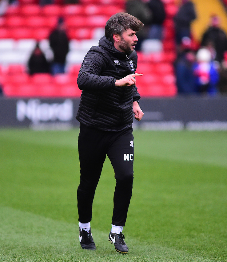 Lincoln City's assistant manager Nicky Cowley during the pre-match warm-up<br /> <br /> Photographer Andrew Vaughan/CameraSport<br /> <br /> The EFL Sky Bet League Two - Saturday 15th December 2018 - Lincoln City v Morecambe - Sincil Bank - Lincoln<br /> <br /> World Copyright © 2018 CameraSport. All rights reserved. 43 Linden Ave. Countesthorpe. Leicester. England. LE8 5PG - Tel: +44 (0) 116 277 4147 - admin@camerasport.com - www.camerasport.com