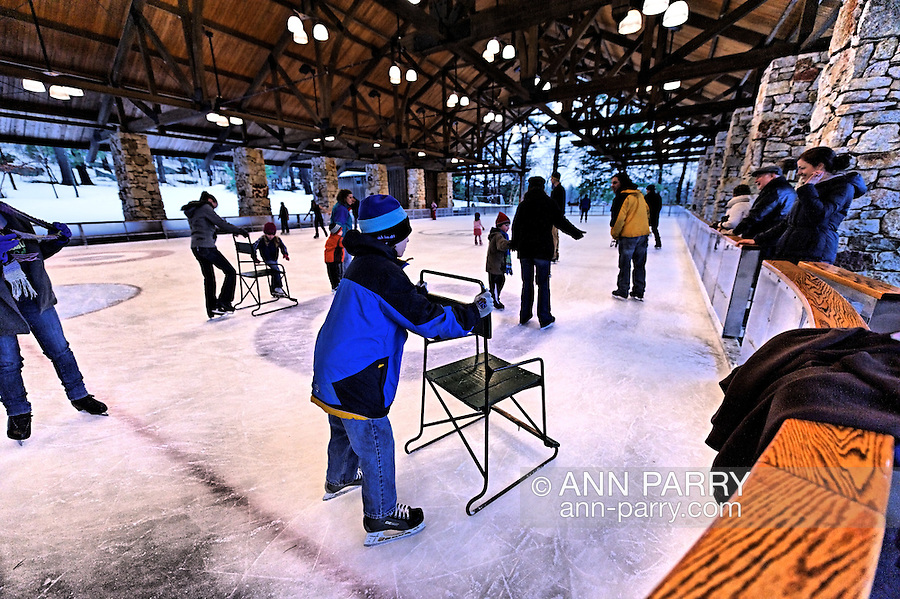 Skaters at Mohonk Mountain House Skating Rink in winter