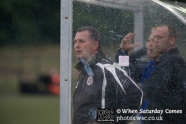 The New Saints 4 Bohemians 0, 20/07/2010. Park Hall Stadium, Champions League 2nd qualifying round 2nd leg. The backroom staff of Irish club Bohemians watching the action through the rain at Park Hall Stadium, Oswestry during their team's Champions League 2nd qualifying round 2nd leg game away to The New Saints. Despite leading 1-0 from the first leg, the Dublin club went out following their 4-0 defeat by the Welsh champions. The match was the first-ever Champions League match in the UK played on an artificial pitch and was staged at the Welsh Premier League's ground which was located over the border in England. Photo by Colin McPherson.