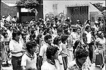Thousands of Zapotec native people shout slogans to defend their leftist municipality government during a popular assembly held by Coalicion Obrera campesina Estudiantil del Istmo (COCEI) on August 7, 1983 at the main plaza of Juchitan, Oaxaca.  © Photo by Heriberto Rodriguez