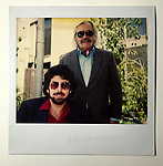 Polaroid of Felix and Robert Landau outside apartment building circa 1975