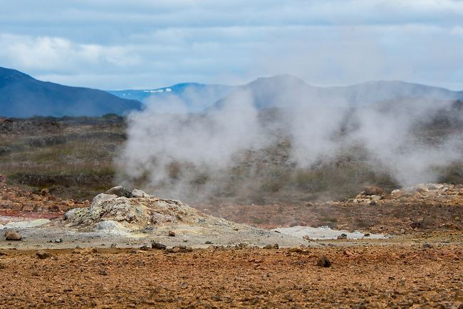 Steaming borehole in the hot spring area named Hverir, east of Mt. Namafjall near Lake Myvatn in Northeast Iceland.