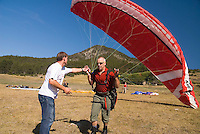 Saint Vincent-les-Forts, Lac de Serre Poncon, France, September 2007. Instructor Roland ter Harkel, guides a student into the air. Op Pad Magazine winner Henk Dijkink, was selected for paragliding training. Volantis is home to the paragliding school Inferno. In one week time, students learn to fly the paraglider and earn their mountain licence 1. Photo by Frits Meyst/Adventure4ever.com