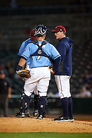NW Arkansas Naturals pitching coach Jim Brower (38) talks with catcher Micah Gibbs (7) and pitcher Malcom Culver (25) during a game against the San Antonio Missions on May 30, 2015 at Arvest Ballpark in Springdale, Arkansas.  San Antonio defeated NW Arkansas 5-2.  (Mike Janes/Four Seam Images)