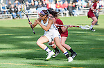 Los Angeles, CA 02/08/13 - Kara Mupo  (Northwestern #8) and Courtney McGrath  (Umass #9) in action during the Northwestern vs UMass NCAA Women's Lacrosse game at USC's McAlister Field.
