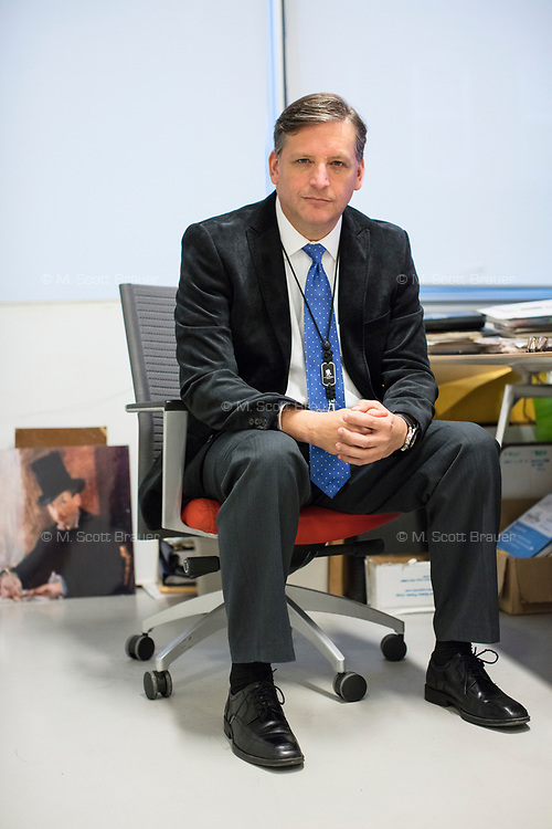 """Anthony Amore is the Directory of Security and Chief Investigator at the Isabella Stewart Gardner Museum in Boston, Mass., USA, seen here in his office on Tues., Dec. 5, 2017. Part of Amore's ongoing work is the investigation into the 1990 theft of 13 pieces from the museum: 10 paintings, 2 objects, and 1 etching. Among the paintings stolen were works by Rembrandt, Vermeer, Degas, and Manet. At left, on the ground, is a reproduction of Manet's """"Chez Tortoni."""" The painting is one of those stolen in the heist."""