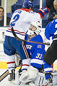 Josh Holmstrom (UML - 12), Clarke Saunders (UAH - 33) - The University of Massachusetts-Lowell River Hawks defeated the University of Alabama-Huntsville Chargers 3-0 on Friday, November 25, 2011, at Tsongas Center in Lowell, Massachusetts.