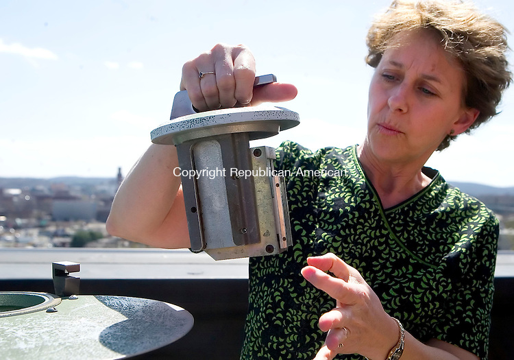 WATERBURY, CT- 23 APRIL 07- 042307JT01-<br /> JoAnn Nedderman, a medical technologist at Waterbury Hospital, looks at the mold and pollen detection system located on the fourth floor roof of the hospital building on Tuesday.<br /> Josalee Thrift Republican-American