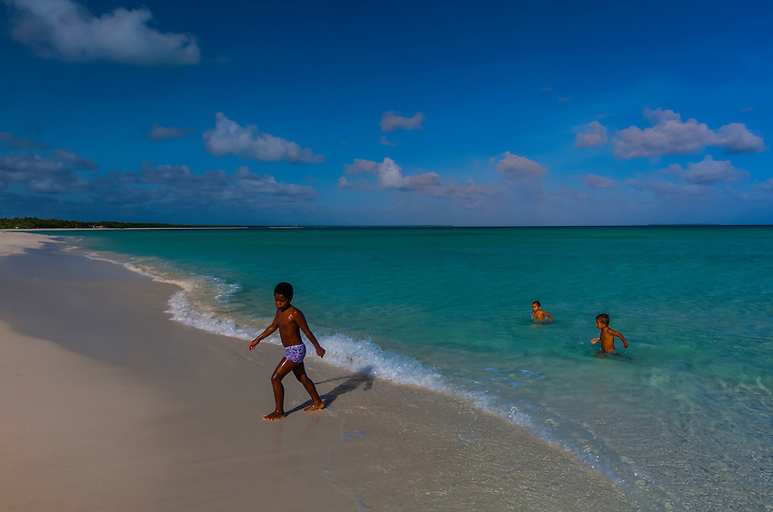Kanak (Melanesian) boys, playing on the beach at Mouli, Island of Ouvea, Loyalty Islands, New Caledonia