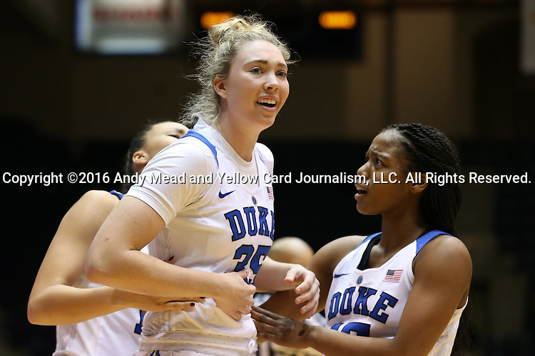 07 January 2016: After a hard foul Duke's Erin Mathias (35) is checked by teammates Kyra Lambert (right) and Faith Suggs (left). The Duke University Blue Devils hosted the Wake Forest University Demon Deacons at Cameron Indoor Stadium in Durham, North Carolina in a 2015-16 NCAA Division I Women's Basketball game. Duke won the game 95-68.