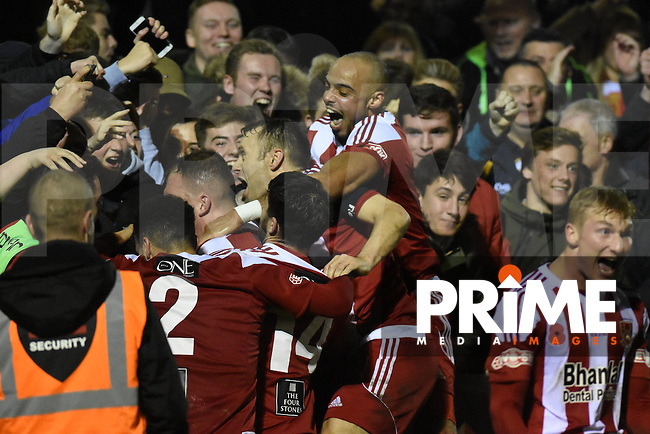 Stourbridge players and fans celebrate Luke Benbow's free-kick goal making it 3-0 during the FA Cup 1st round replay match between Stourbridge and Whitehawk  at the War Memorial Athletic Ground, Stourbridge, England on 14 November 2016. Photo by Garry Griffiths.