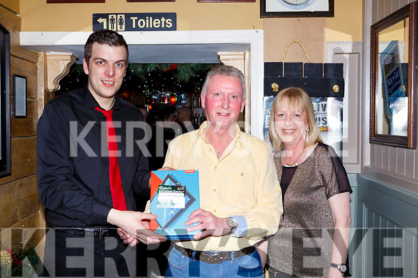 Johnny Culloty collecting Carlsberg Christmas Cracker promotion prize of a Tablet in the Brogue Inn last Saturday night, l-r, Paul Barker of the Brogue Inn, Johnny Culloty and Margaret Kelliher