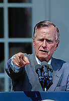 ***FILE PHOTO*** George H.W. Bush Has Passed Away<br /> Washington, DC., USA, 1991<br /> President George H.W. Bush talks with and answers reporters questions during a press conference in the Rose Garden of the White House <br /> CAP/MPI/MRN<br /> &copy;MRN/MPI/Capital Pictures