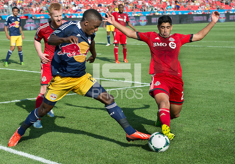 20 July 2013: New York Red Bulls midfielder/forward Marius Obekop #13 and Toronto FC midfielder Matias Laba #20 in action during an MLS regular season game between the New York Red Bulls and Toronto FC at BMO Field in Toronto, Ontario Canada.<br /> The game ended in a 0-0 draw.