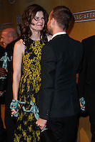 LOS ANGELES, CA - JANUARY 18: Betsy Brandt, Aaron Paul in the press room at the 20th Annual Screen Actors Guild Awards held at The Shrine Auditorium on January 18, 2014 in Los Angeles, California. (Photo by Xavier Collin/Celebrity Monitor)