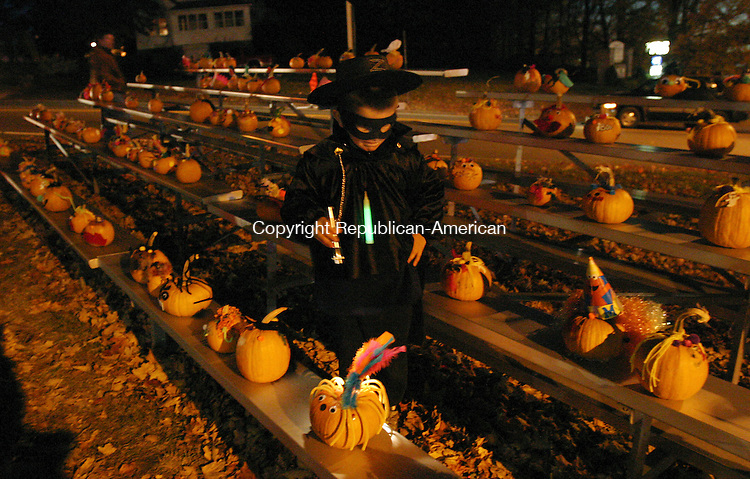 PROSPECT, CT 10/28/07- 102807BZ02- Ryan Knobel, 5, a kindergartner at Algonquin School, tries to find the pumpkin he decorated during Prospect's annual pumpkin festival Sunday night.<br /> Jamison C. Bazinet Republican-American