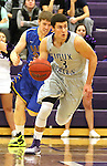 SIOUX FALLS, SD - NOVEMBER 24: Mack Johnson #3 from the University of Sioux Falls pushes the ball past Taylor Zirbel #34 from Dakota State University in the first half of their game Monday night at the Stewart Center.  (Photo by Dave Eggen/Inertia)