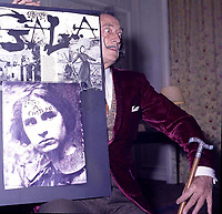 """portrait of Salvador Dali in his suite at hotel Maurice Paris,<br /> 1973,<br /> , - Salvador Domènec Felip Jacint Dalí i Domènech, Marquis de Púbol (May 11, 1904 – January 23, 1989), commonly known as Salvador Dalí  was a prominent Spanish Catalan surrealist painter born in Figueres.<br /> <br /> Dalí was a skilled draftsman, best known for the striking and bizarre images in his surrealist work. His painterly skills are often attributed to the influence of Renaissance masters.His best-known work, The Persistence of Memory, was completed in 1931. Dalí's expansive artistic repertoire includes film, sculpture, and photography, in collaboration with a range of artists in a variety of media.<br /> <br /> Dalí attributed his """"love of everything that is gilded and excessive, my passion for luxury and my love of oriental clothes to a self-styled """"Arab lineage,"""" claiming that his ancestors were descended from the Moors.<br /> <br /> Dalí was highly imaginative, and also had an affinity for partaking in unusual and grandiose behavior. His eccentric manner and attention-grabbing public actions sometimes drew more attention than his artwork to the dismay of those who held his work in high esteem and to the irritation of his critics -"""
