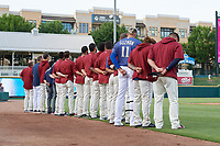 Frisco RoughRiders line up for the national anthem before a Texas League game against the Springfield Cardinals on May 6, 2019 at Dr Pepper Ballpark in Frisco, Texas.  (Mike Augustin/Four Seam Images)