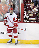 Adam Reasoner 30 of Boston College calls out to a teammate while Andrew Joudrey 24 of the University of Wisconsin watches play. The Boston College Eagles defeated the University of Wisconsin Badgers 3-0 on Friday, October 27, 2006, at the Kohl Center in Madison, Wisconsin in their first meeting since the 2006 Frozen Four Final which Wisconsin won 2-1 to take the national championship.<br />