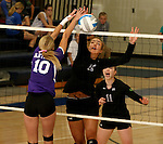 SIOUX FALLS, SD - SEPTEMBER 25: Lindsey Smith #10 from Dakota Valley battles for the ball with Paige DeJong #12 from Sioux Falls Christian in the first game of their match Thursday night at Sioux Falls Christian High.  (Photo by Dave Eggen/Inertia)